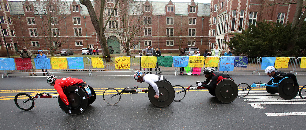 (Wellesley, MA - 4/20/15) Wheelchair racers pass Wellesley College during the Boston Marathon, Monday, April 20, 2015. Staff photo by Angela Rowlings.