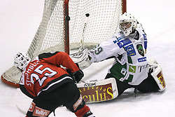 Conny Stromberg vs Goalkeeper of Olimpija Matija Pintaric at 2nd final match of Slovenian National Championships  between HK Acroni Jesenice and HDD Tilia Olimpija, on March 17, 2009, in Podmezaklja, Jesenice, Slovenia. Acroni Jesenice won after free shots 2:1 and are leading 2:0. They need to win 2-times more. (Photo by Vid Ponikvar / Sportida)