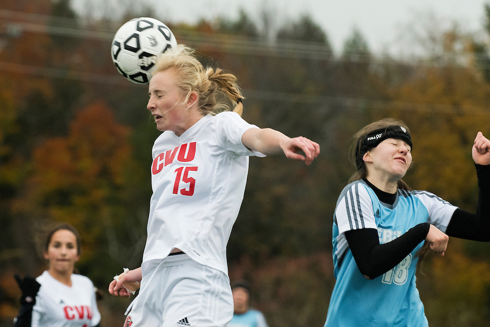 CVU's Sierra Morton (15) leaps to head the ball during the girls high school playoff game between the Champlain Valley Union Redhawks and the South Burlington Rebels at South Burlington High School on Saturday afternoon October 29, 2016 in South Burlington. (BRIAN JENKINS/for the FREE PRESS)
