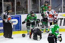 28.09.2014, Hala Tivoli, Ljubljana, SLO, EBEL, HDD Telemach Olimpija Ljubljana vs HC TWK Innsbruck, 6. Runde, in picture Puck hits referee Florian Widman during the Erste Bank Icehockey League 6. Round between HDD Telemach Olimpija Ljubljana and HC TWK Innsbruck at the Hala Tivoli, Ljubljana, Slovenia on 2014/09/28. Photo by Matic Klansek Velej / Sportida