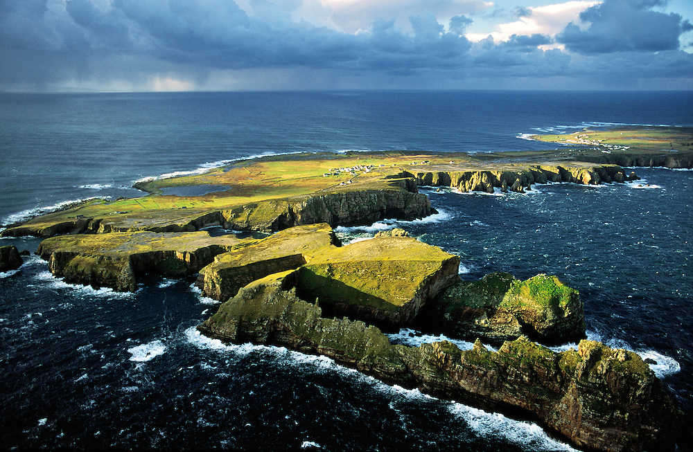 Tory Island, Co. Donegal, Ireland. Celtic Balor's Fort on flat top peninsula. Hut circles, defence ditch and rampart visible.