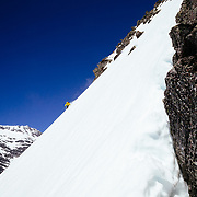 Andy Mahre skiing a ridgline in the backcountry of Glacier National Park.