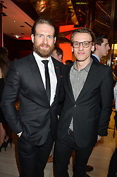 Left to right, actors CRAIG McGINLAY and JAMIE CAMPBELL BOWER at the launch of the new Ferrari 488 Spider held at Watches of Switzerland, 155 Regent Street, London on 25th February 2016.