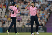James Fuller of Middlesex is congratulated on his fifth wicket and finished with figures of 6-28 during the Vitality T20 Blast South Group match between Hampshire County Cricket Club and Middlesex County Cricket Club at the Ageas Bowl, Southampton, United Kingdom on 20 July 2018. Picture by Dave Vokes.