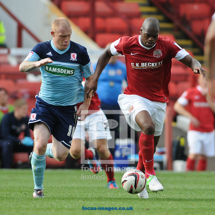 Picture by Richard Land/Focus Images Ltd +44 7713 507003.18/08/2012.Marlon Harewood of Barnsley and Nicky Bailey of Middlesbrough during the npower Championship match at Oakwell, Barnsley.