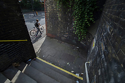 © Licensed to London News Pictures. 26/08/2016. Redhill, UK. Police are appealing for witnesses after it was reported that a boy was taken into a van on Thursday evening from this alley on the Redstone Hill Road next to Redhill railway station. Photo credit: Peter Macdiarmid/LNP