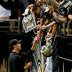 Sep 21, 2014; New Orleans, LA, USA; New Orleans Saints quarterback Drew Brees signs autographs before a game against the Minnesota Vikings at Mercedes-Benz Superdome. Mandatory Credit: Derick E. Hingle-USA TODAY Sports