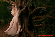 (Boston 25 most stylish people) Boston, Ma 10/17/06  Carolina Blodgett (Cq) photographed at the Arnold Arboretum in Jamaica Plain on OCt. 17, 2006 wearing a dress she made herself in two years made out of organza. She is leaning against the oldest dawn-red tree in America, the root source of all red-dawns in America, this one was originally from China. (Suarez, Essdras M/ Globe staff)/ Living Arts..