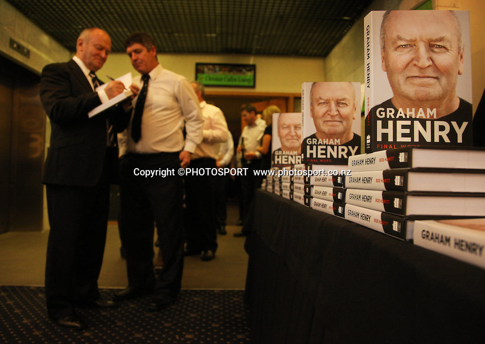 """Graham Henry signs his new book for a guest. A Tribute to Sir Graham Henry Dinner and book launch, """"Final Word"""". Twiggers, Addington Raceway, Christchurch, Thursday 23 August 2012. Photo : Joseph Johnson/photosport.co.nz"""