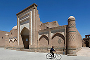 Man cycling past the corner of Muhammad Amin Inaq Madrasah, 1785, in Khiva, Uzbekistan, pictured on July 5, 2010 in the summer morning light.