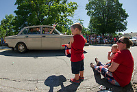 Aiden holds out his hat as an antique tossed candy to the crowds during the Gilmanton 4th of July parade Tuesday morning.  (Karen Bobotas/for the Laconia Daily Sun)