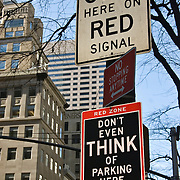 No Parking Sign at busy pedestrian crossing area in Midtown Manhattan