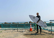 "THE ATOMIC SURFERS FROM FUKUSHIMA<br /> <br /> On march 11 at 2:46 pm 2011, Japan was hit by a 9.0  earthquake magnitude which generated a tsunami on the japanese coasts. Here in Futaba beach, the giant wave has broken the first floor of an hotel.<br /> <br /> 18,500 people died , 90% drowned by the tsunami wave . The bodies of 2,561 of these people were not found. Steles are visible along the roads to honor them.<br /> <br /> <br /> <br /> 5 years later, the scars of the tsunami are still visible like  in Tomioka town . The law now prohibits to live in areas destroyed by the tsunami . Only the industrial or commercial activities are allowed, but the candidates are very few to come.<br /> <br /> <br /> <br /> The road  fences have been bent by the strenght of the waves. Only the police patrols in the area to monitor the few houses still standing and controlling the curious visitors. In the distance the speakers encourage visitors and workers to consult a doctor in case of persistent headaches .<br /> <br /> <br /> <br /> The tsunami hit the Daaitchi nuclear plant , that can be spotted from Futaba beach . The disaster was rated level 7, the equivalent of Chernobyl. In 5 years, nearly 50 000 people have worked with strong financial incentives to decontaminate the plant and stop the leaks.<br /> <br /> <br /> Radiations sensors indicate the radioactivity level, but in these red zones classified as "" difficulty to return zone"" by the governement,  there is no one to read. 1 millisievert is the maximum permissible exposure limit during one year for humans..<br /> <br /> <br /> Depending on the degree of contamination in which is their home , residents receive compensation from TEPCO company. In the red zone they receive $ 1,000 per month per person . This creates tension in the population because those who are on the other side of the fence as here in Tomioka , receive nothing.<br /> <br /> <br /> In the « orange zone » , residents have the right to visit their home if they want to take care of it, like here in Naraha . This man comes weeding his garden. His wife refuses to come , and he will not bring his childre"