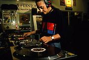 DJ Colin Favor at work on Technics decks and mixer, UK, 1990's