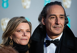 Dominique Lemonnier and Alexandre Desplat attending 72nd British Academy Film Awards, Arrivals, Royal Albert Hall, London. 10th February 2019