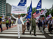 09 JUNE 2018 - SEOUL, SOUTH KOREA: A supporter of former South Korean President Park Geun-hye marches in a pro-American rally in downtown Seoul. President Park was ousted after a corruption scandal rocked her administration. Participants said they wanted to thank the US for supporting South Korea and they hope the US will continue to support South Korea. Many were also opposed to ongoing negotiations with North Korea because they don't think Kim Jong-un can be trusted to denuclearize or to not attack South Korea.     PHOTO BY JACK KURTZ