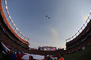 Jets fly over the stadium during the playing of the National Anthem in this wide angle, general view photograph taken before the Denver Broncos 2016 NFL week 1 regular season football game against the Carolina Panthers on Thursday, Sept. 8, 2016 in Denver. The Broncos won the game 21-20. (©Paul Anthony Spinelli)