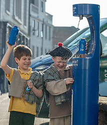 Youngsters paid tribute to one of Dumfries&rsquo; most celebrated former residents when they unveiled a new water refill tap in the town.<br /> <br /> The high tech Top Up Tap has been installed by Scottish Water as part of its national initiative to encourage people to carry a reusable bottle and stay hydrated on the go. <br /> <br /> Pictured: Primary 2 pupils from Noblehill Primary School who donned 18th century outfits and recited some poems by Robert Burns.