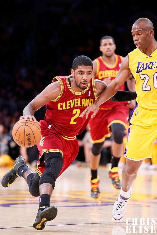 14 January 2014: Cleveland Cavaliers point guard Kyrie Irving (2) drives past Los Angeles Lakers shooting guard Jodie Meeks (20) during the Cleveland Cavaliers 120-118 victory over the Los Angeles Lakers at the Staples Center, Los Angeles, California, USA.