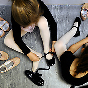 Kris Wilson/News Tribune.Young dancers swap out their ballet shoes for their tap shoes during an afternoon pre-ballet/tap class for 4 and 5-year-olds at Dancer's Alley on Monday.