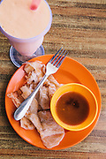 Roti canai and mango shake breakfast at a café on Jalan Pentai Chanang, Langkawi