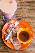 Roti canai and mango shake breakfast at a café on Jalan Pentai Chanang, Langkawi