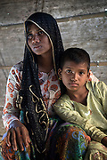 Rohingya refugee crisis. Dildar Begum and her daughter Noor Kalima. Survivors of the massacre at Tula Toli (Min Gyi village) in Mayanmar. Balukhali refugee camp, Cox's Bazar District, Bangladesh - Photograph by David Dare Parker