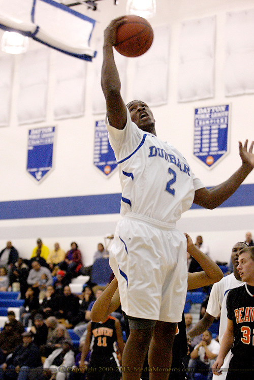 Wolverine Gary Akbar (2) at the basket in the second quarter as the Beavercreek Beavers play the Dunbar High School Wolverines at Dunbar High School in Dayton, Tuesday, January 3, 2012.