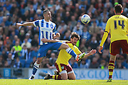 Brighton central midfielder Beram Kayal & Burnley midfielder Joey Barton vattle for possession during the Sky Bet Championship match between Brighton and Hove Albion and Burnley at the American Express Community Stadium, Brighton and Hove, England on 2 April 2016. Photo by Bennett Dean.