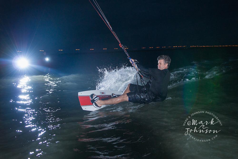Kitesurfing at night in Moreton Bay, Queensland, Australia
