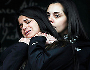 Erica Lafferty, daughter of Sandy Hook Elementary School shooting victim, Dawn Hochsprung, right, consoles Carlee Soto, sister of victim Victoria Soto addressing the media, Monday, Dec. 9, 2013, in Newtown, Conn. Newtown is not hosting formal events to mark the anniversary Saturday. (AP Photo/Jessica Hill)