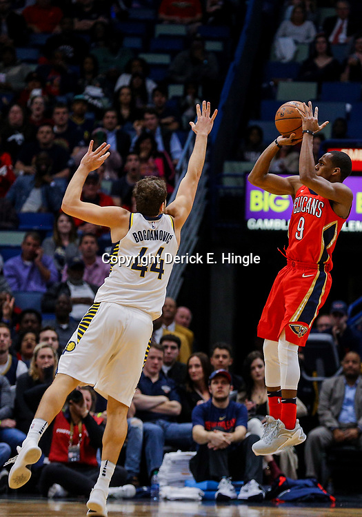 Mar 21, 2018; New Orleans, LA, USA; New Orleans Pelicans guard Rajon Rondo (9) shoots over Indiana Pacers forward Bojan Bogdanovic (44) during the second quarter at the Smoothie King Center. Mandatory Credit: Derick E. Hingle-USA TODAY Sports