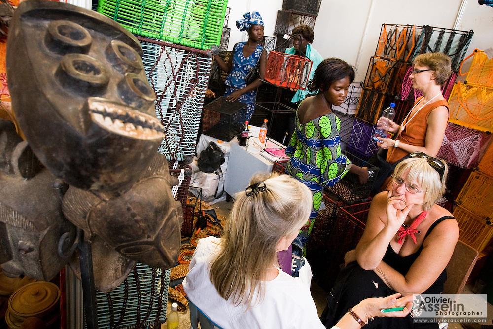 Visitors browse in a booth selling baskets at the 22nd Salon International de l'Artisanat de Ouagadougou (SIAO) in Ouagadougou, Burkina Faso on Sunday November 2, 2008.