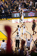 Golden State Warriors forward Andre Iguodala (9) and Golden State Warriors guard Klay Thompson (11) celebrate a buzzer beater against the Houston Rockets in the first half at Oracle Arena in Oakland, Calif., on March 31, 2017. (Stan Olszewski/Special to S.F. Examiner)