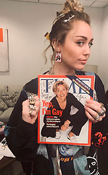 """Miley Cyrus releases a photo on Twitter with the following caption: """"""""Happy Birthday @TheEllenShow"""""""". Photo Credit: Twitter *** No USA Distribution *** For Editorial Use Only *** Not to be Published in Books or Photo Books ***  Please note: Fees charged by the agency are for the agency's services only, and do not, nor are they intended to, convey to the user any ownership of Copyright or License in the material. The agency does not claim any ownership including but not limited to Copyright or License in the attached material. By publishing this material you expressly agree to indemnify and to hold the agency and its directors, shareholders and employees harmless from any loss, claims, damages, demands, expenses (including legal fees), or any causes of action or allegation against the agency arising out of or connected in any way with publication of the material."""