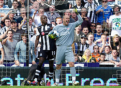 NEWCASTLE-UPON-TYNE, ENGLAND - Sunday, April 1, 2012: Liverpool's goalkeeper Jose Reina appeals after clashing with Newcastle United's James Perch (on the floor), which leads to his sending off, during the Premiership match at St James' Park. (Pic by Vegard Grott/Propaganda)
