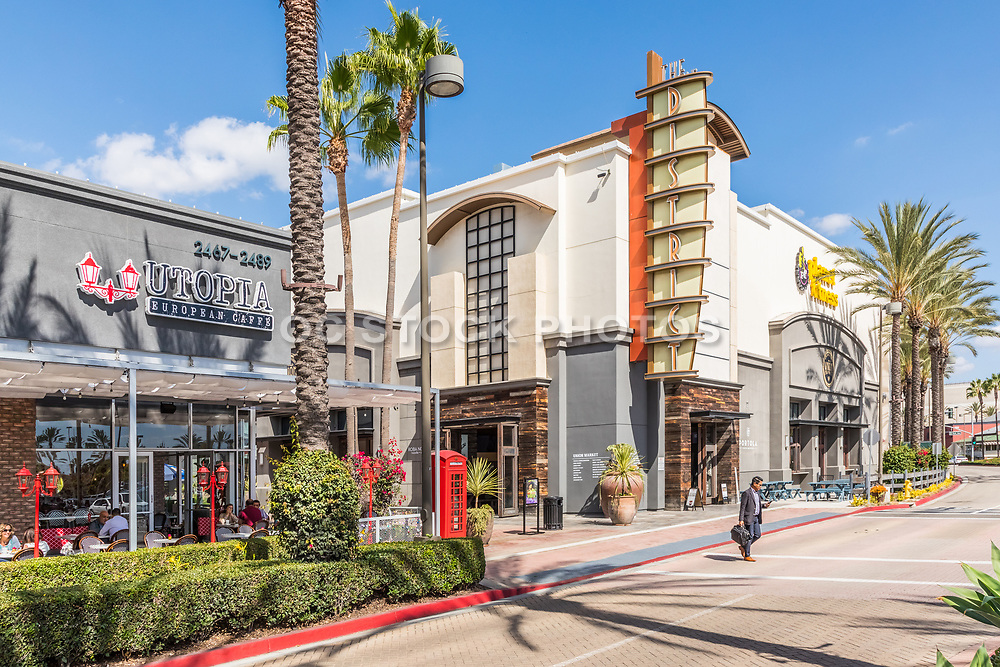 Man Crosses the Street by Utopia European Cafe at The District in Tustin