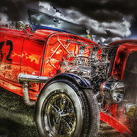 Vintage retro classic car in red under stormy sky