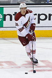 Mar 24, 2012; San Jose, CA, USA; Phoenix Coyotes defenseman Michael Stone (26) warms up before the game against the San Jose Sharks at HP Pavilion.  San Jose defeated Phoenix 4-3 in shootouts. Mandatory Credit: Jason O. Watson-US PRESSWIRE