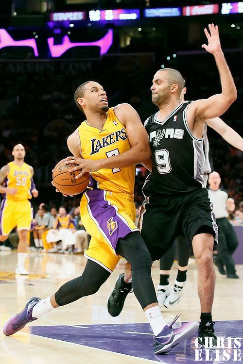 19 March 2014: Los Angeles Lakers forward Xavier Henry (7) drives past San Antonio Spurs guard Tony Parker (9) during the San Antonio Spurs 125-109 victory over the Los Angeles Lakers at the Staples Center, Los Angeles, California, USA.