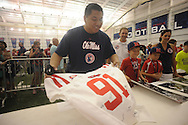 "Javier Boyas gets autographs on a jersey during ""Meet The Rebels"" at the Manning Center in Oxford, Miss. on Saturday, August 16, 2014. Members of the Ole Miss football, soccer, volleyball, rifle, and women's golf teams, as well as the spirit squads, greeted fans and signed autographs."
