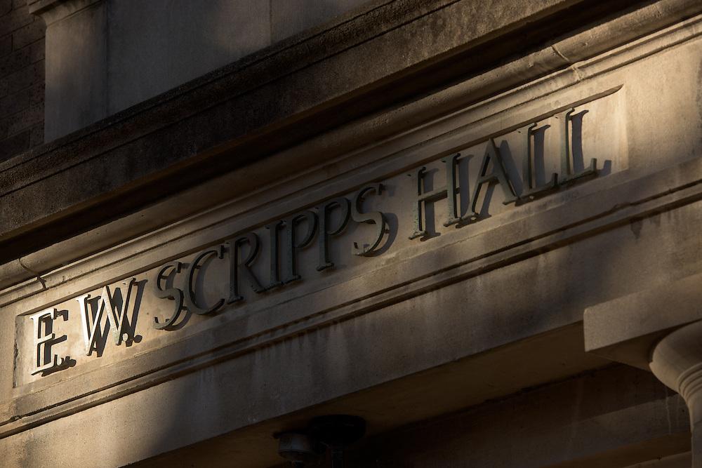 Light shines through nearby trees onto E.W. Scripps Hall in Ohio University on November 12, 2016.