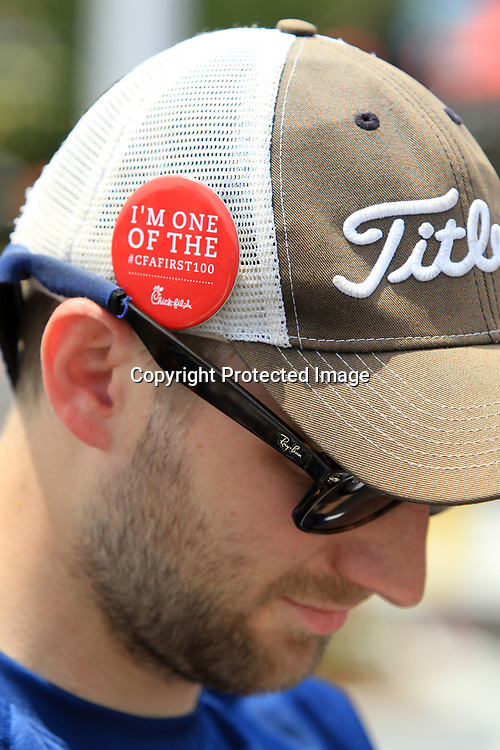 Matthew Nunnelee, of Tupelo, wears his CFAFIRST100 pin on his hat as he camps out with others in the parking lot of the new Chick-fil-a in Tupelo on Wednesday. Nunnelee arrived at the restaurant at 5:15AM with Hopper arriving at 4:30AM. The restaurant reopens Thursday morning, but the first 100 people in line get free Chick-fil-a for a year.