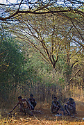 Hadzabe bushmen in the shade of a tree at mid day.  Lake eyasi, northern Tanzania.
