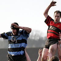 The ball manages to escape both Shannon's Dave Keane and Ennis' Brian Frawley during their Munster Junior Cup clash in Ennis Rugby Grounds on Sunday.<br /> <br /> Photograph by Yvonne Vaughan.