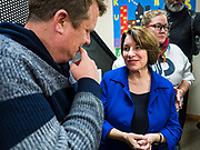 19 JANUARY 2020 - DES MOINES, IOWA: US Senator AMY KLOBUCHAR (D-MN), right, talks to people who came to see her during a campaign event at Urban Dreams in Des Moines. Sen. Klobuchar brought her presidential campaign to Urban Dreams, a community empowerment center in central Des Moines. Iowa hosts the first event of the presidential selection process in February. The Iowa Caucuses are Feb. 3, 2020.        PHOTO BY JACK KURTZ