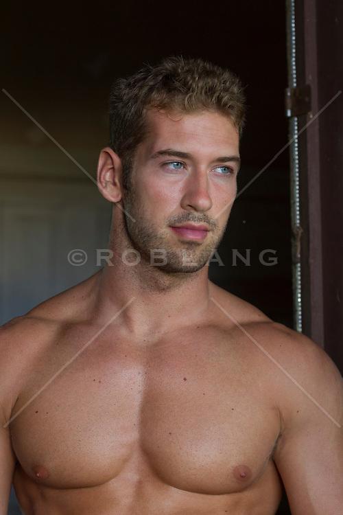 Shirtless man looking off