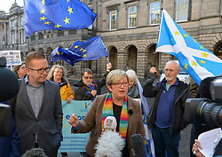 Pictured: Joanna Cherry speaks to the media  outside the Court after the ruling.<br /> <br /> A cross-party group of over 70 politicians today won their appeal before the Court of Session seeking to rule that the UK government and Prime Minister Boris Johnson acted unlawfully in proroguing parliament.<br /> <br /> © Dave Johnston / EEm