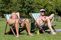 © Licensed to London News Pictures. 24/08/2019. London, UK. Two men sunbathes in deckchairs in London's St James's Park as the hot weather continues. According to the Met Office, the temperatures are forecast to reach between 31 and 33 degrees celsius in the south-east of England. <br /> <br /> ***Permission Granted***<br /> <br /> Photo credit: Dinendra Haria/LNP