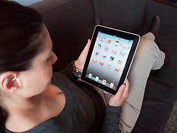 Woman using iPad computer tablet at home